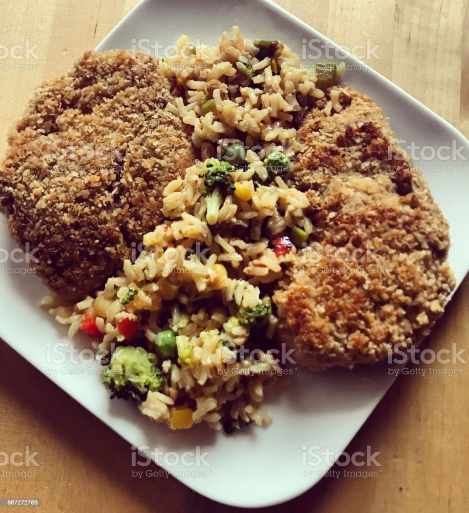 Rice with Homemade Chicken nuggets made with oat bran stock photo