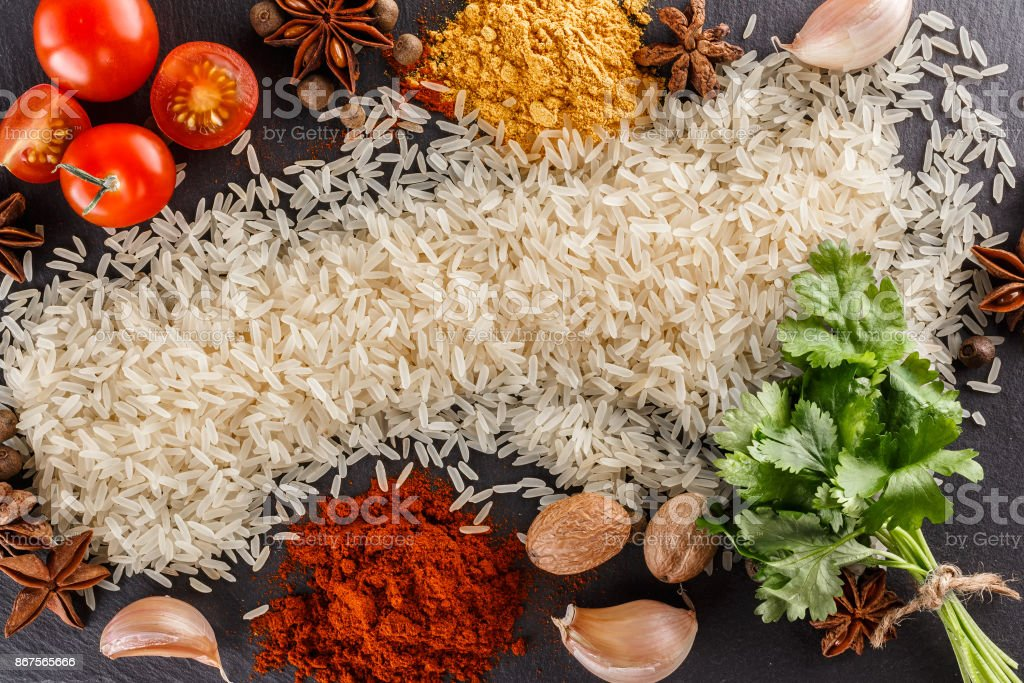 Rice with ingredients. A number of products. Recipe of rice with spices. The view from the top. stock photo