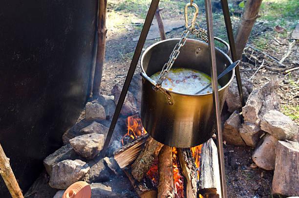 rice with meat on a campfire - planenzelt stock-fotos und bilder