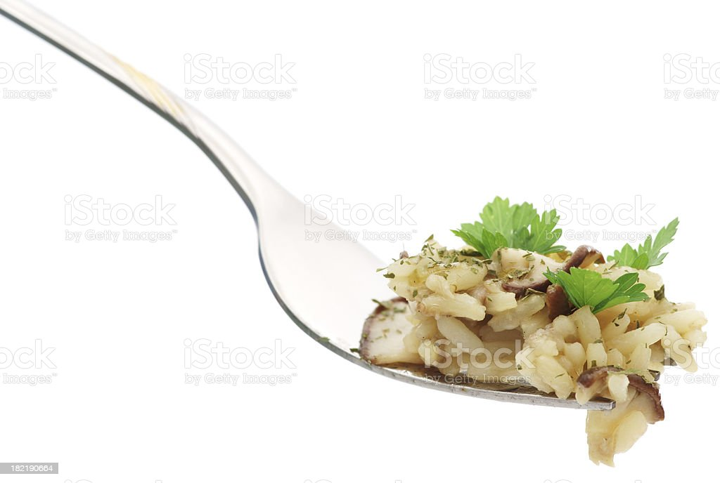 Rice with parsley and mushrooms on fork royalty-free stock photo