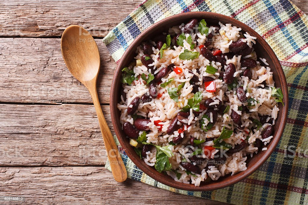 Rice with red beans and vegetables. horizontal top view stock photo