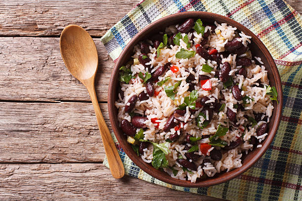 rice with red beans and vegetables. horizontal top view - bean stock photos and pictures