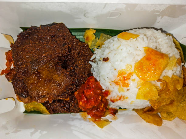 Rice with Rendang on a Box Creative Image rendang stock pictures, royalty-free photos & images