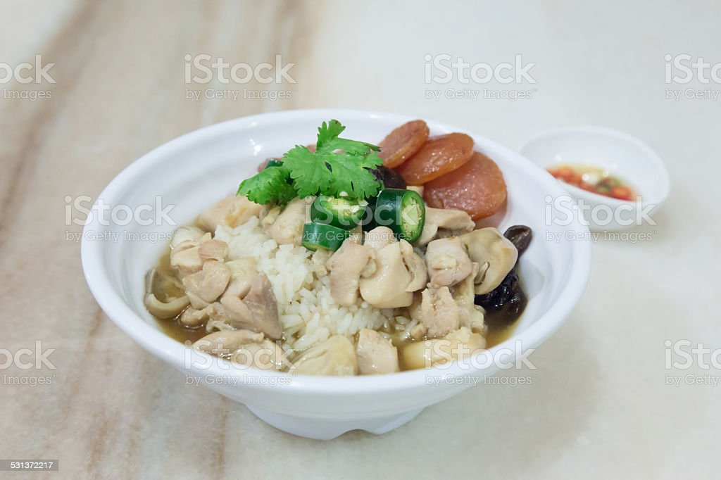 Rice With Steamed Chicken And Sausage On Plate stock photo