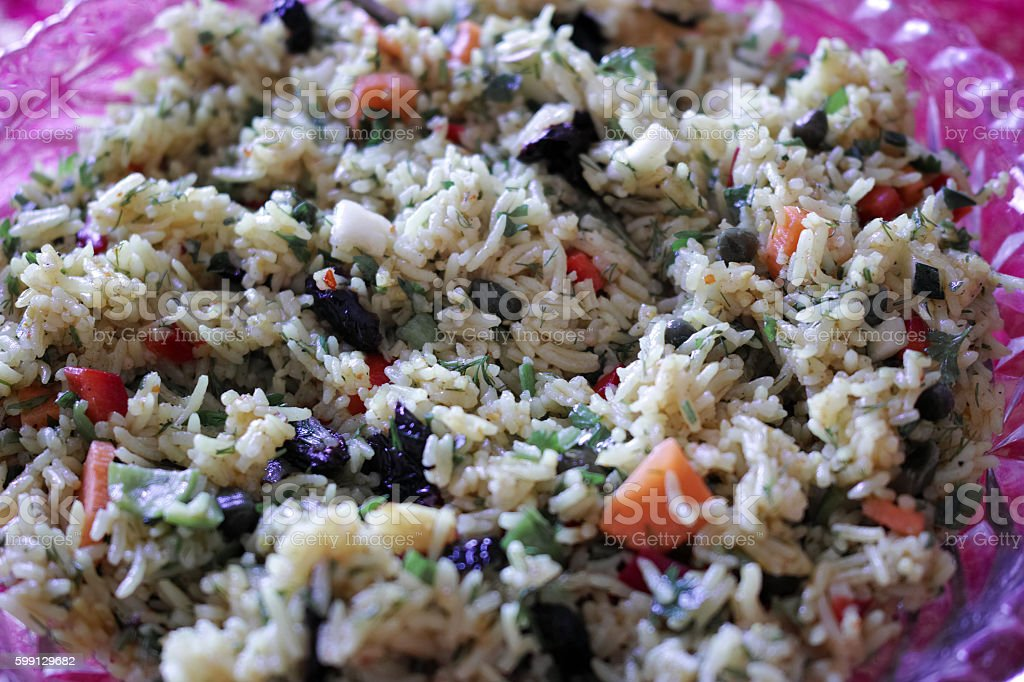 Rice with Vegetables on Pink Dish stock photo