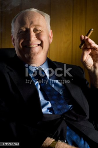 Old Rich Man Smoking a Cigar
