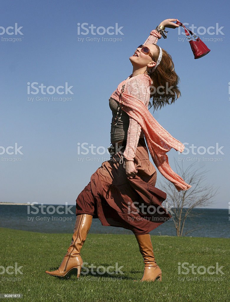rich blond woman walking royalty-free stock photo