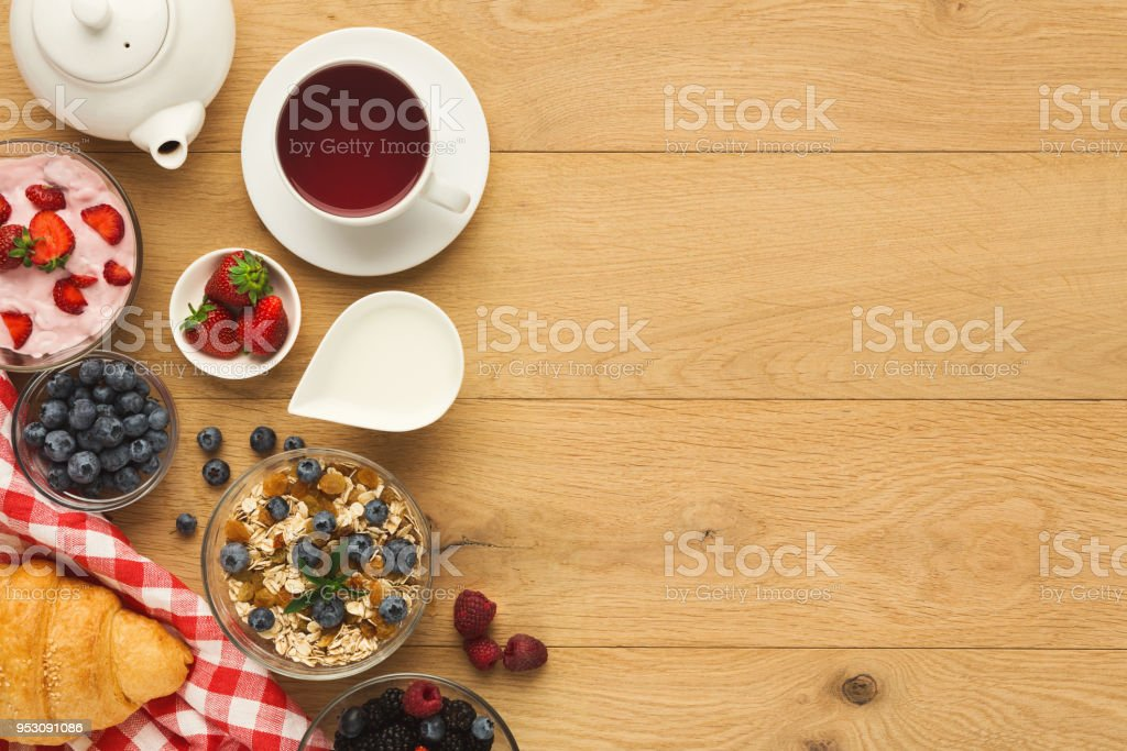 Tasty breakfast with light greek yogurt, muesli, fresh organic...