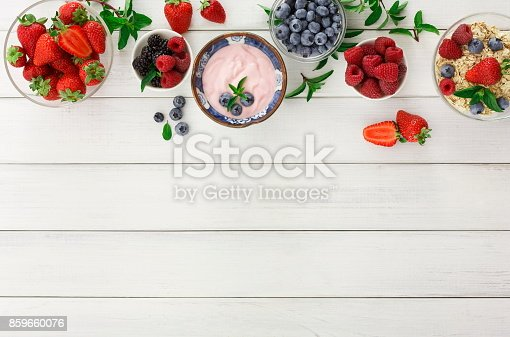 862604802 istock photo Rich breakfast on white wooden table 859660076