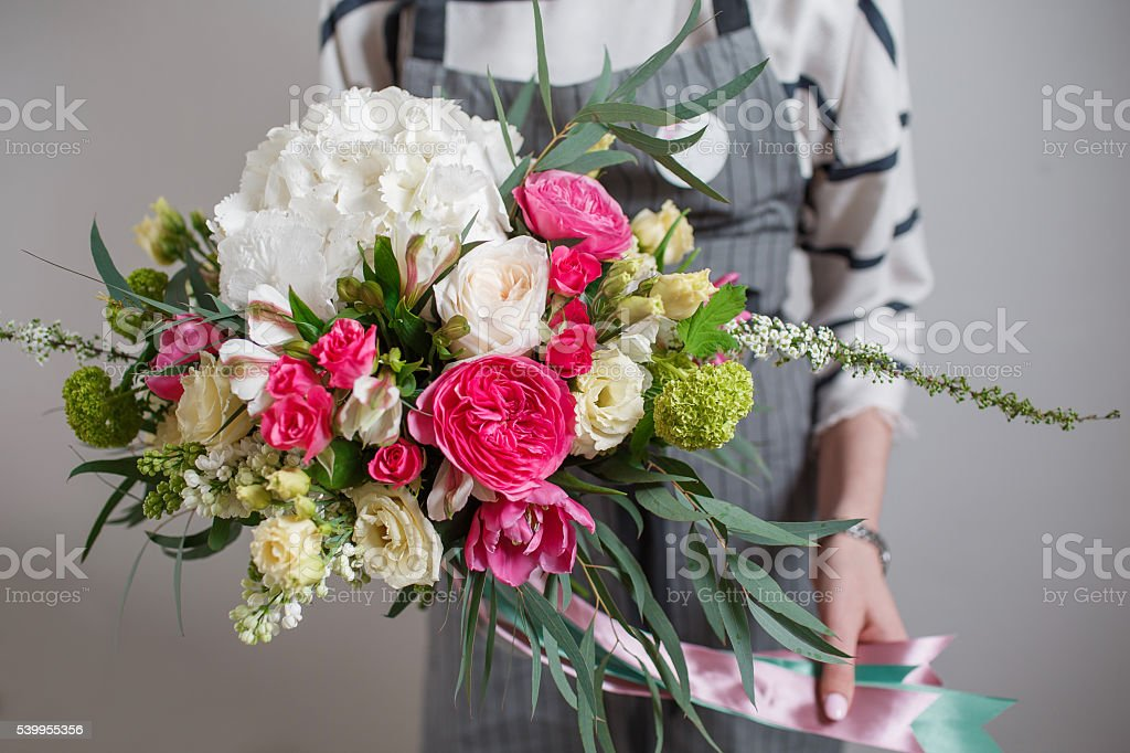 Rich bunch of flowers, green leaf in hand Fresh spring stock photo