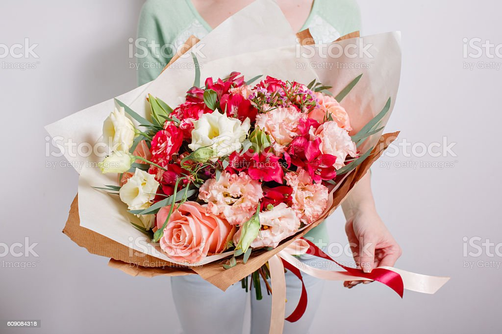 Rich bunch of pink eustoma and roses flowers, green leaf stock photo