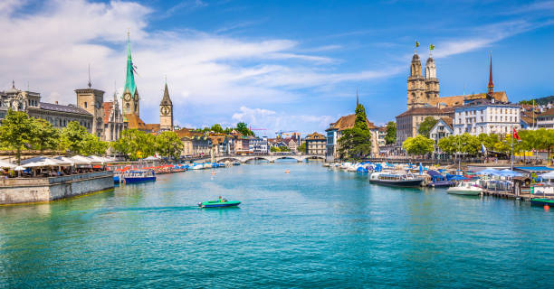 Zürich city center with river Limmat, Switzerland Panoramic view of historic Zurich city center with famous Fraumunster, Grossmunster and St. Peter and river Limmat at Lake Zurich on a sunny day with clouds in summer, Canton of Zurich, Switzerland limmat river stock pictures, royalty-free photos & images