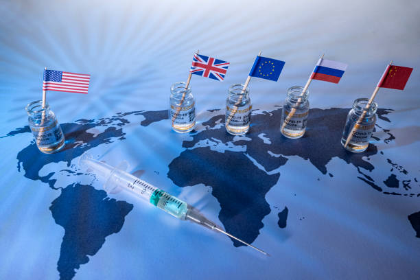 Rich country flags on world map with vials for the global SARS/COVID pandemic vaccine war, with vaccine hoarding, restricting equal access to vaccines across the world, caused by vaccine nationalism and lack of vaccine solidarity stock photo