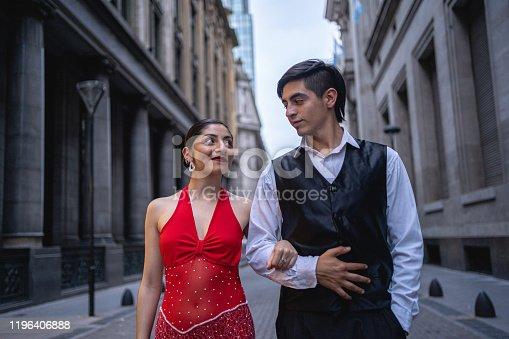 High society couple enjoying a walk through town together