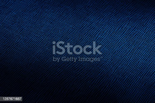 836574134 istock photo rich dark blue abstract texture background with spot of light 1257671657