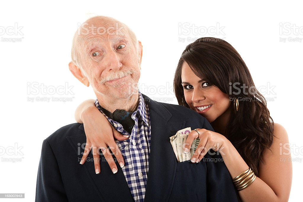 Rich elderly man with gold-digger companion or wife stock photo