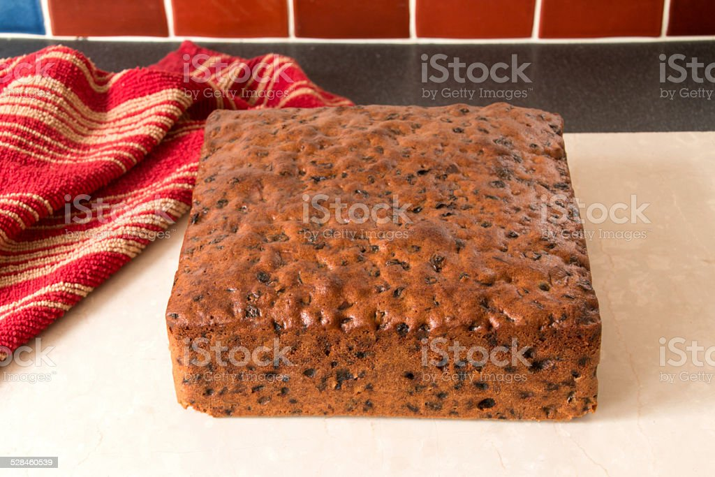Rich fruit cake, square cake cooked ready to ice stock photo