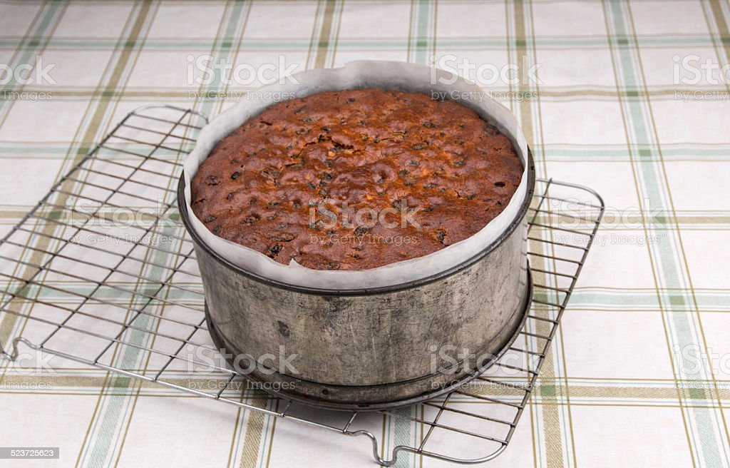 Rich fruit/ Simnel cake ready cooked on wire cooling rack stock photo