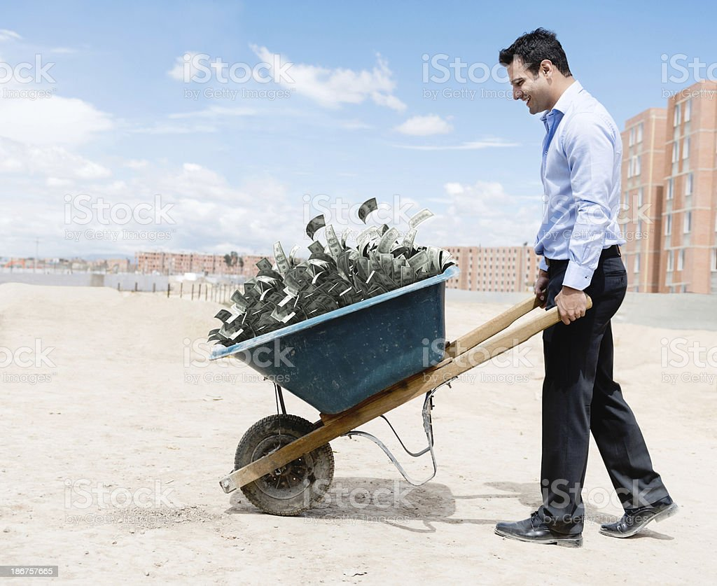 Rich man carrying money stock photo