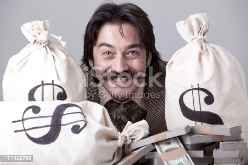 istock Rich man counting down money 172469789