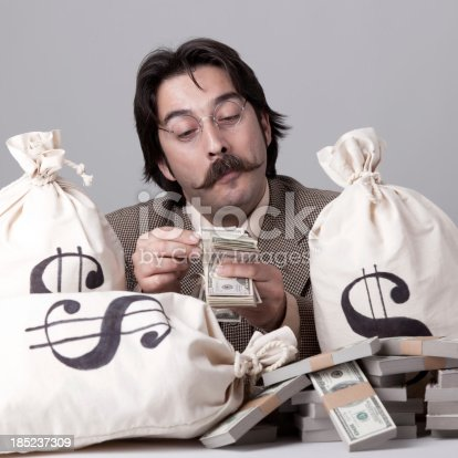 istock Rich man counting down money 185237309