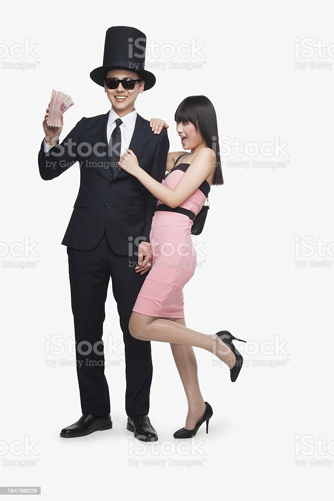Rich Man Holding Money with Girl stock photo