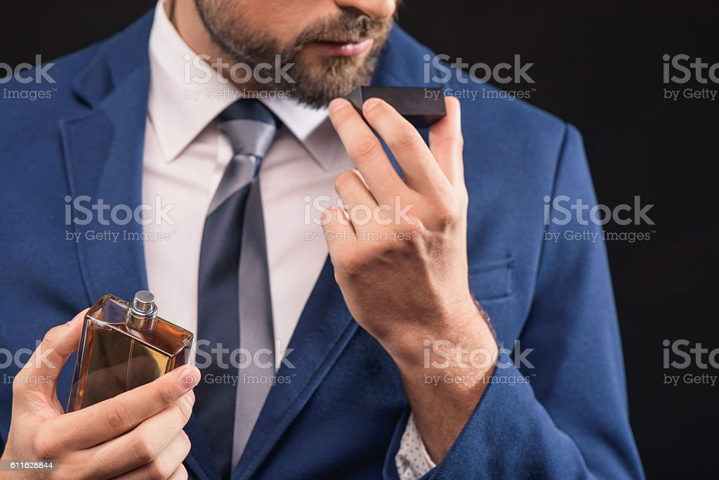 Rich man prefers expensive cologne stock photo