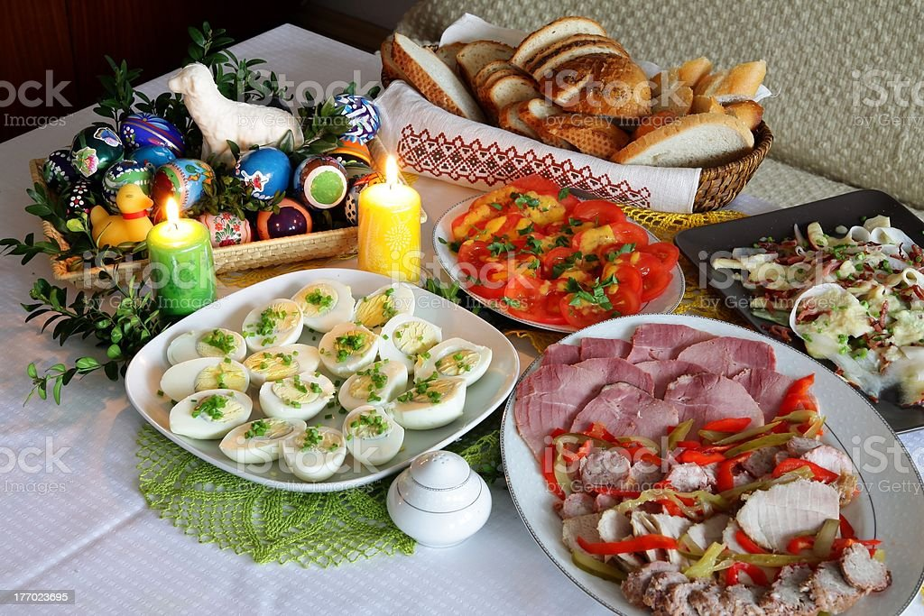 rich of various food Easter table with candle royalty-free stock photo