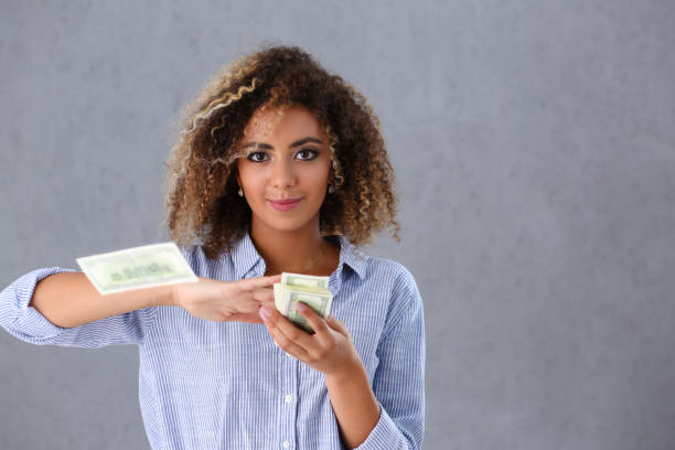 rich pretty woman with cash - throw money away stock pictures, royalty-free photos & images