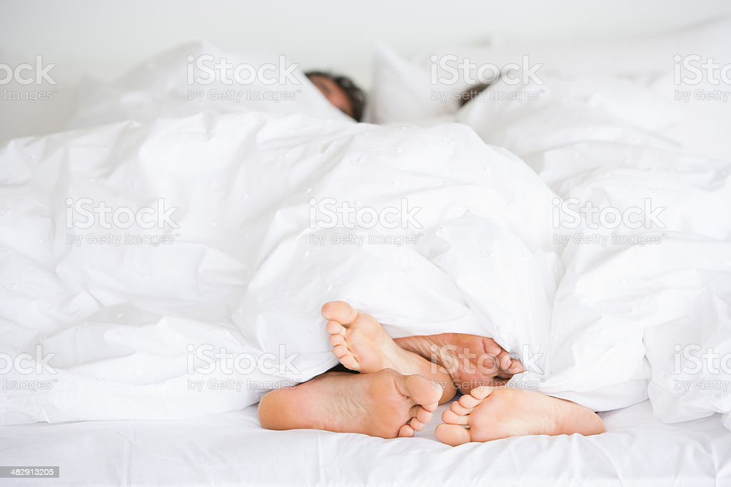 Richard & Kirstin bed feet -009 stock photo