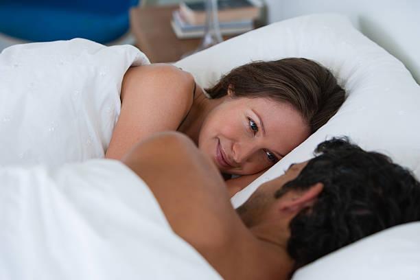 Richard & Kirstin sleeping in bed 0061 stock photo