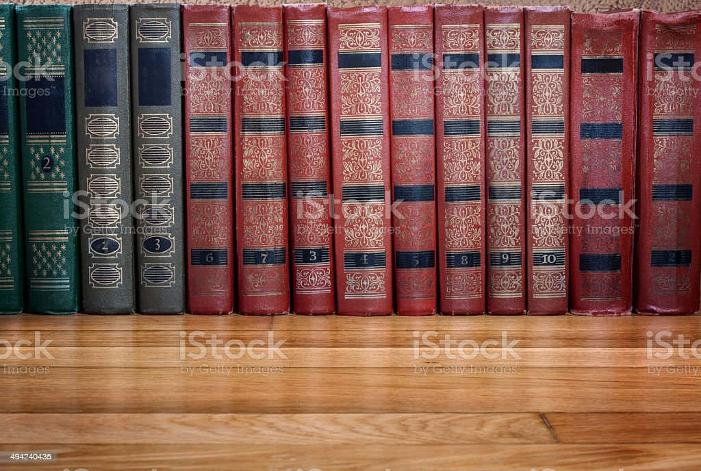 Richly decorated volumes of books with a gold lettering royalty-free stock photo