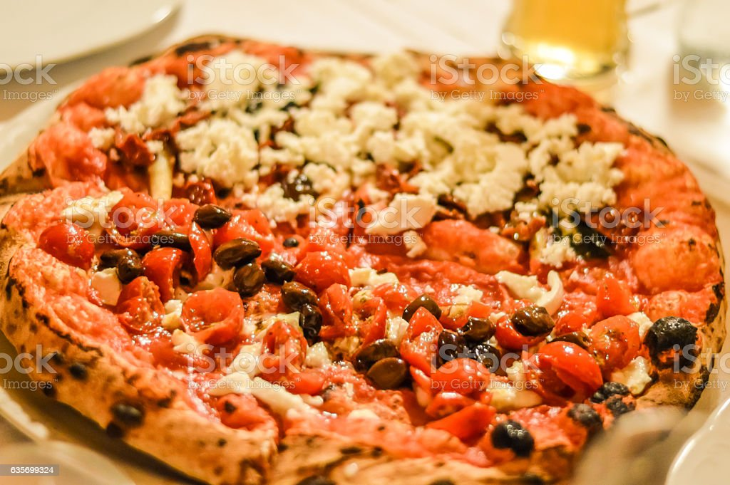 richly garnished pizza close up royalty-free stock photo