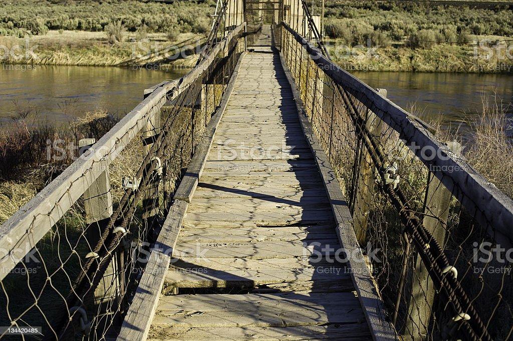 Rickety Worn Bridge Over Colorado River royalty-free stock photo