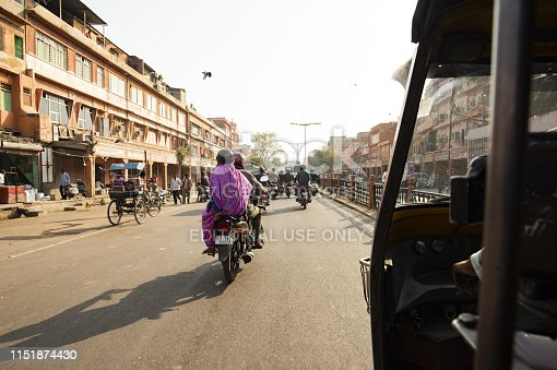 Jaipur, Rajasthan, India, December 12, 2018. A rickshaw (also known as Tuc Tuc) driver is driving on the streets of Jaipur in India. Jaipur is the capital and the largest city of the Indian state of Rajasthan, India.