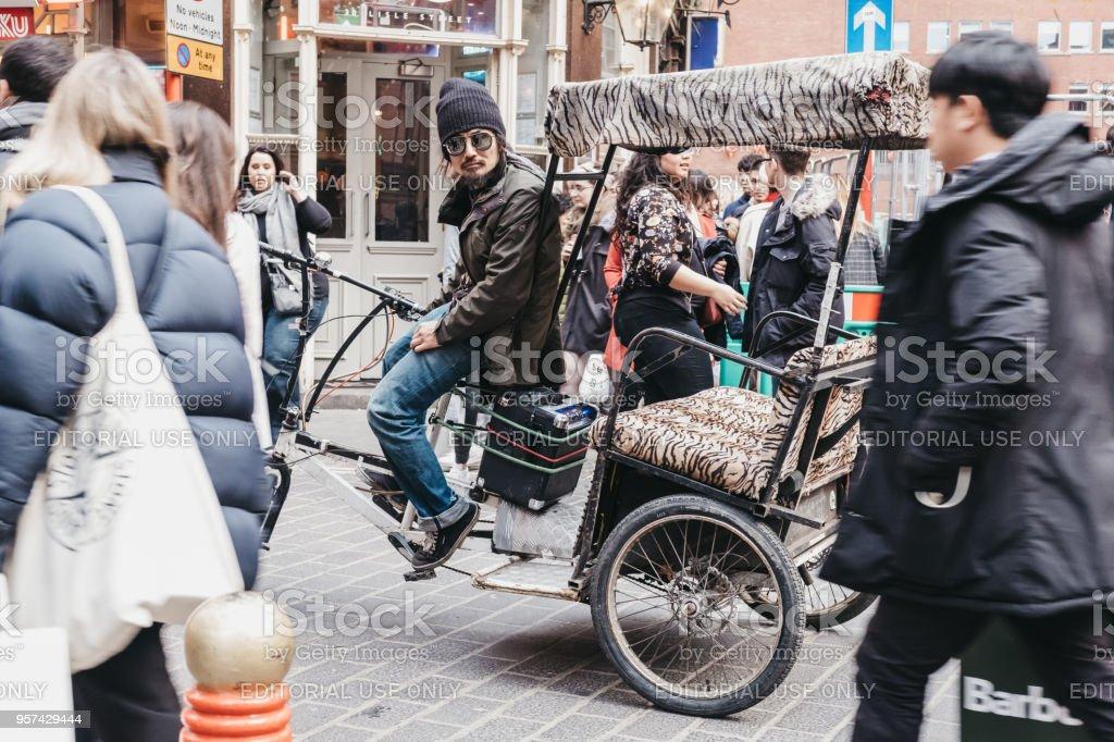 Rickshaw driver waiting for passengers in Covent Garden, London, UK. stock photo