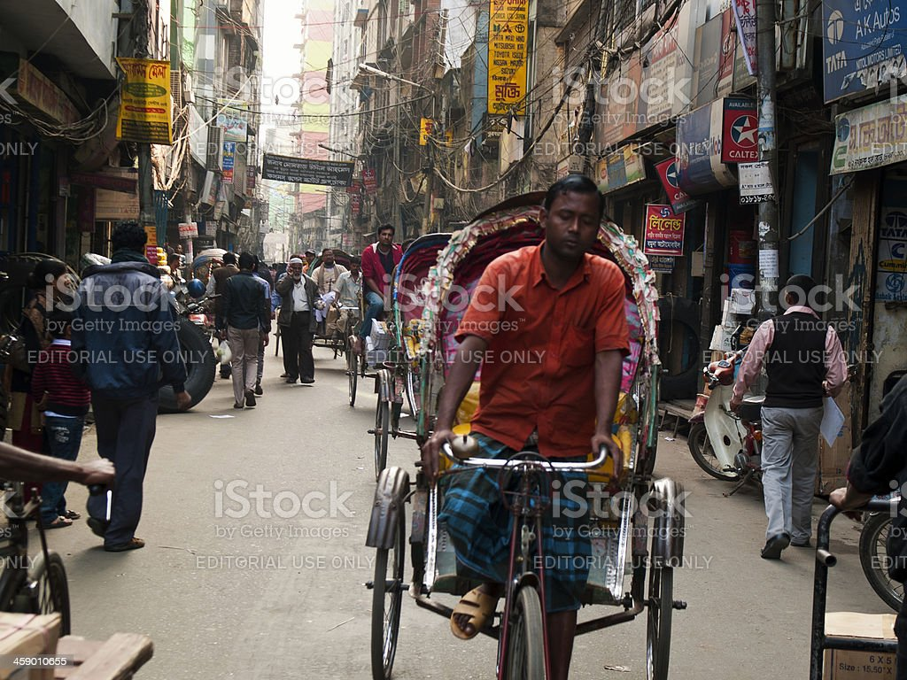 Rickshaw drivers on the crowded streets of Dhaka in Bangladesh stock photo