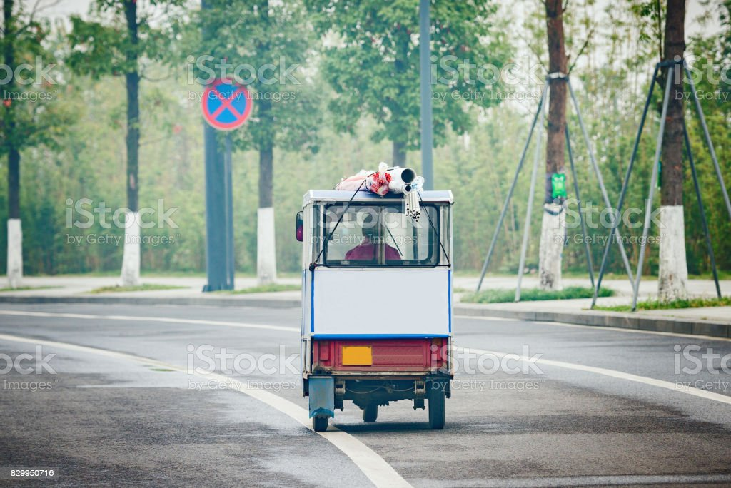 Rickshaw on the empty road at foggy morning time. stock photo