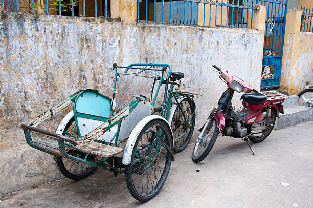 rickshaw or cyclo in vietnam - motorbike, umbrella stock pictures, royalty-free photos & images