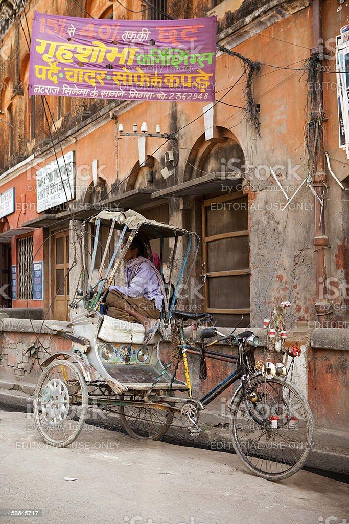 Rickshaw puller on break from India royalty-free stock photo