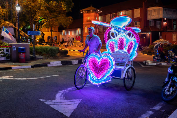 Rickshaw with Hello Kitty style on the streets of Malacca stock photo