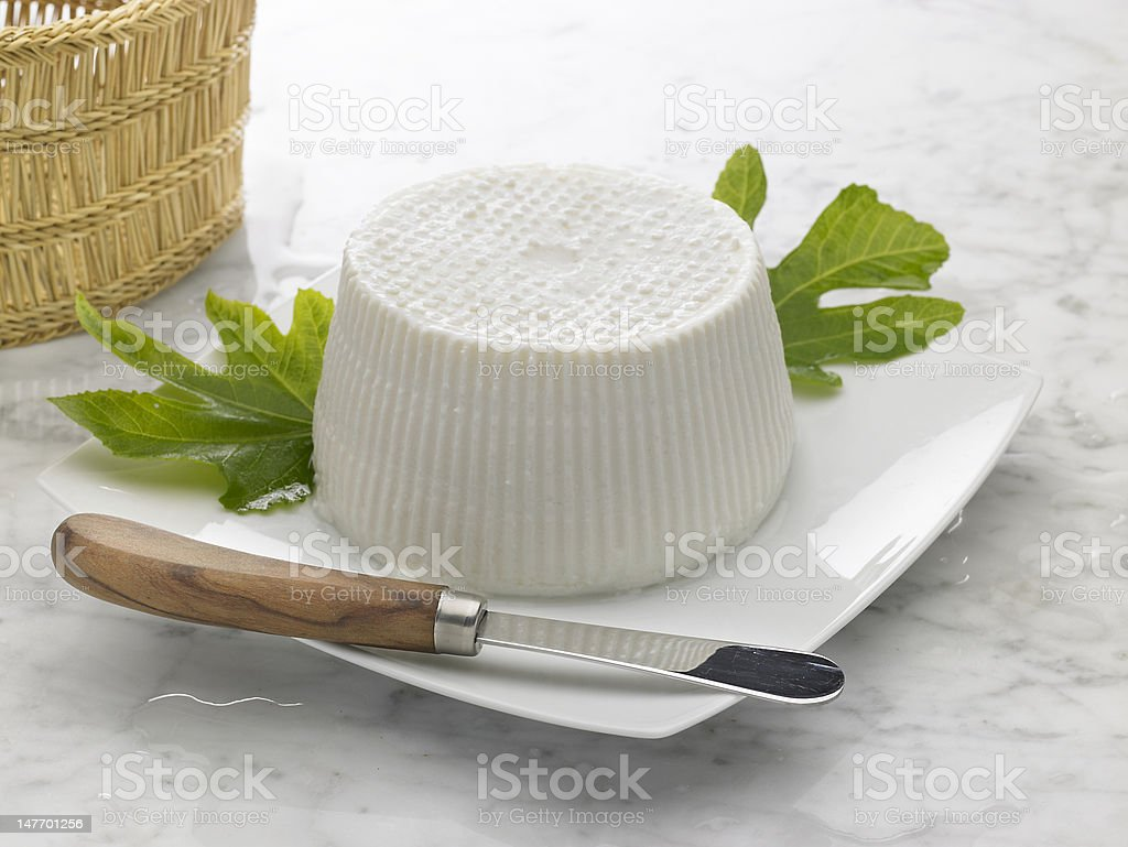 ricotta and fig leaves stock photo