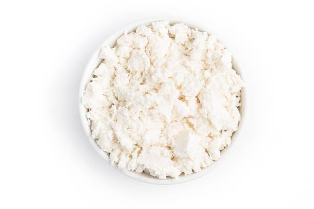 ricotta cheese into a bowl - ricotta stock-fotos und bilder