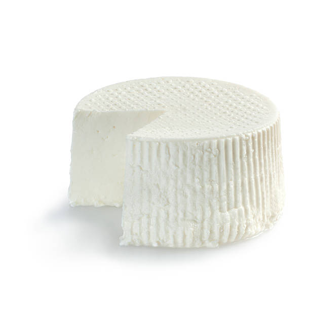 Ricotta cheese, just cutted on white background stock photo