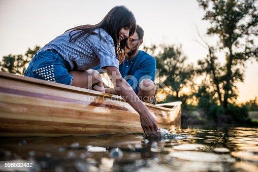 Couple enjoying a boat ride on the lake.