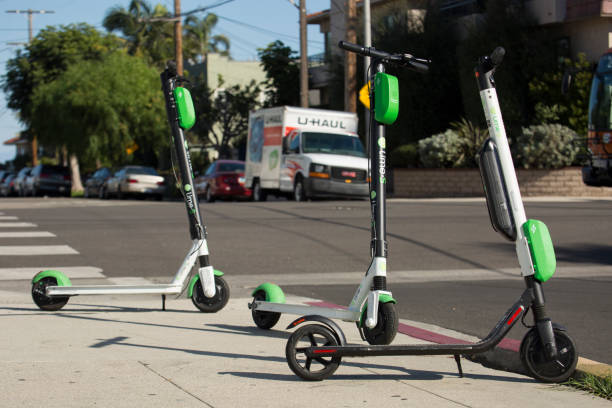 ride share scooter - electric push scooter stock photos and pictures