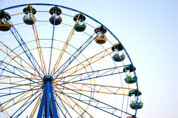 ride the Ferris wheel ride the Ferris wheel, selective focus ferris wheel stock pictures, royalty-free photos & images
