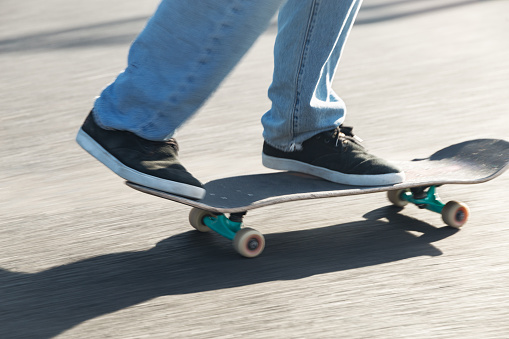 Ride your skateboard around town. Skateboard close-up
