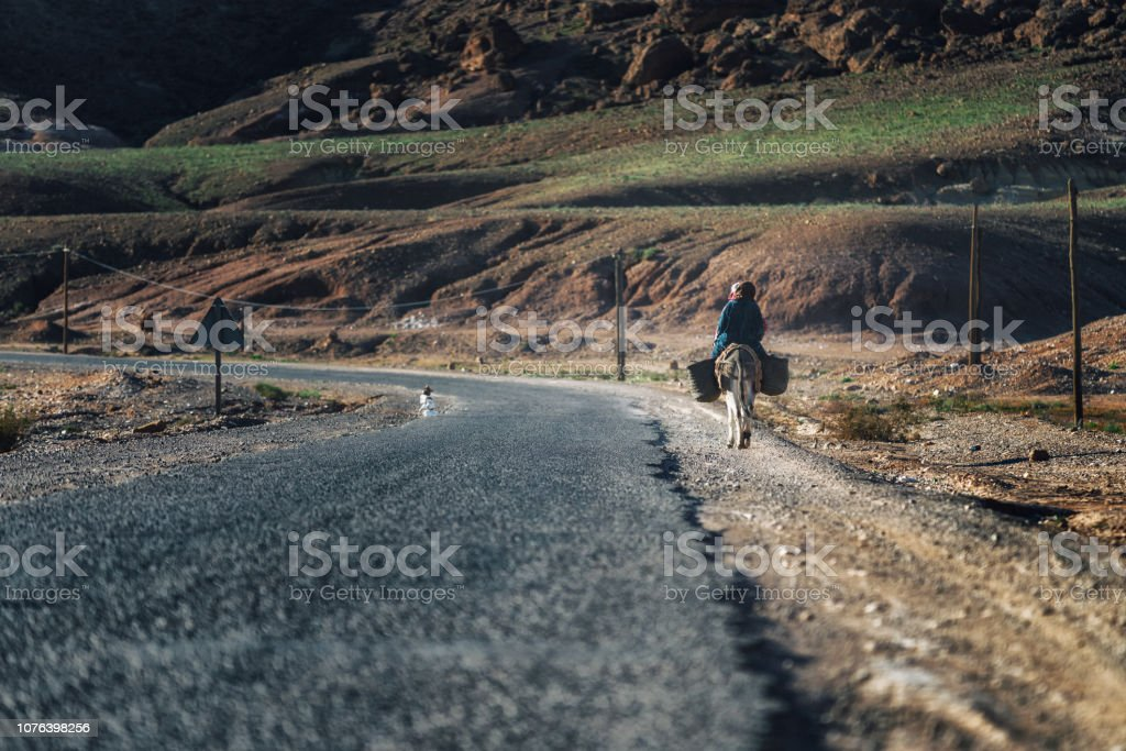 rider along the road in Morocco stock photo