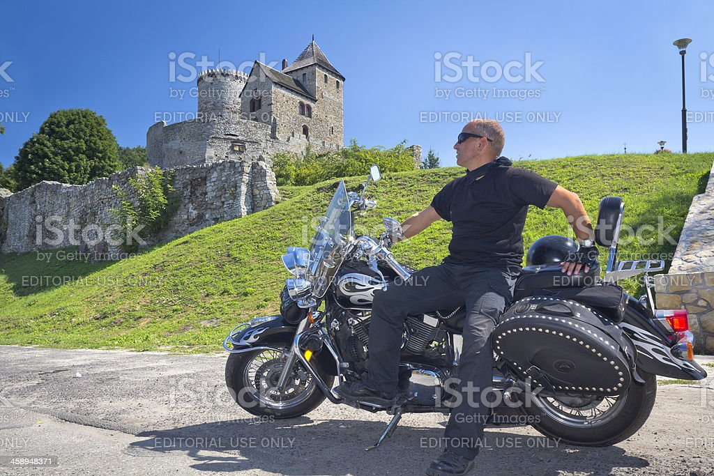Rider and old castle stock photo